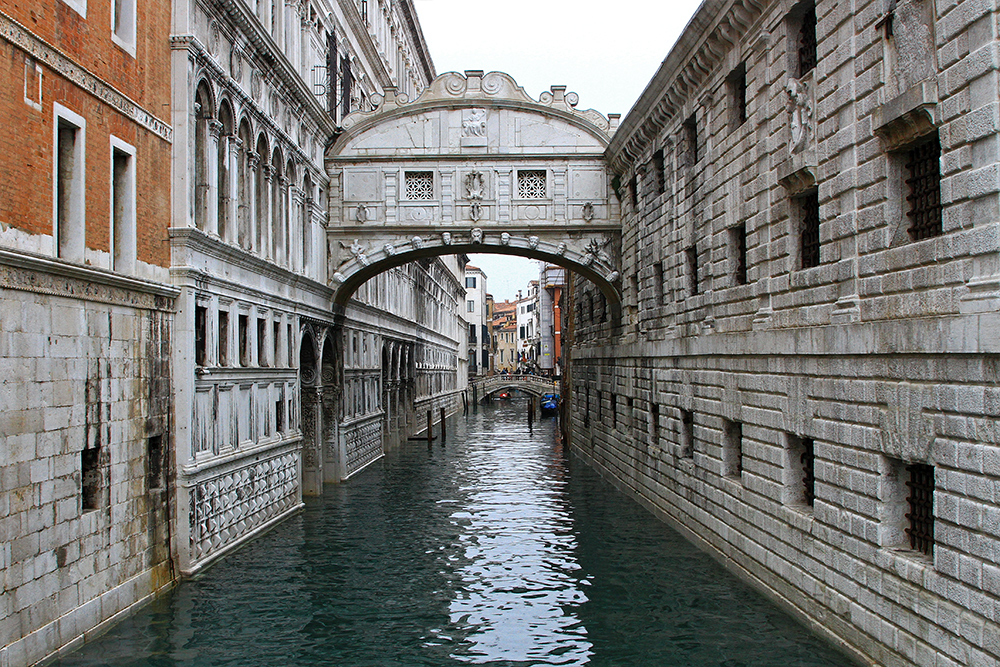 "Ponte dei Sospiri ""Bridge of Sights"" in Venice connects the New Prison to the interrogation rooms in the Doge's Palace."