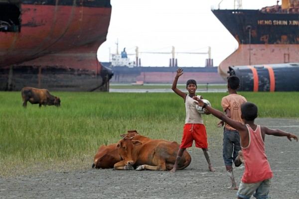 Kids playing in between the Ship Breaking Yard in Chittagong, Bangladesh.