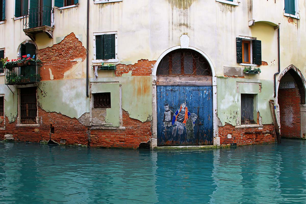 """Street Art"" can also be found along the canals in Venice."