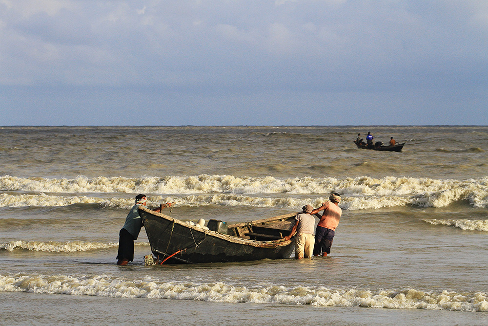 Fishermen on the beach in Kuakata, Bangladesh.