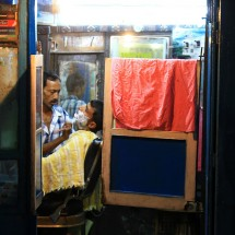 A barber shop in Varanasi at night.