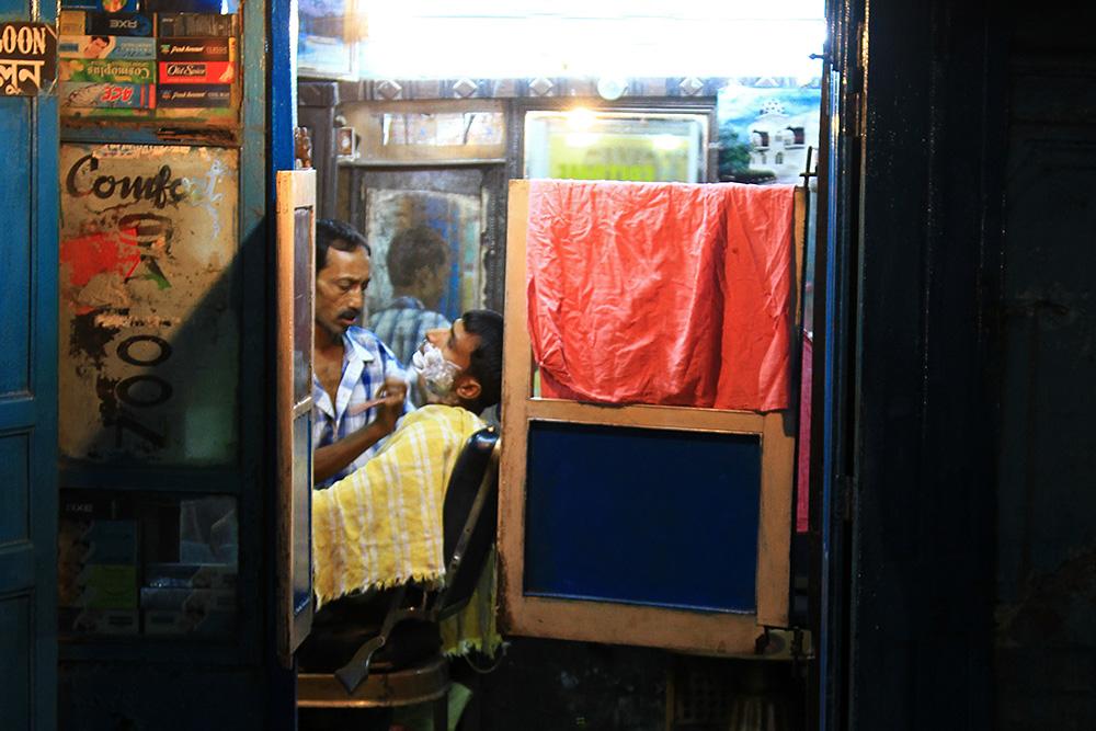 A barber shop in Varanasi at night.