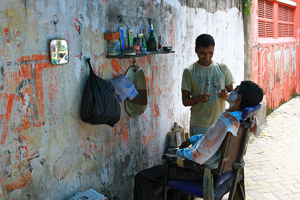 A typical barber in the side streets of India.
