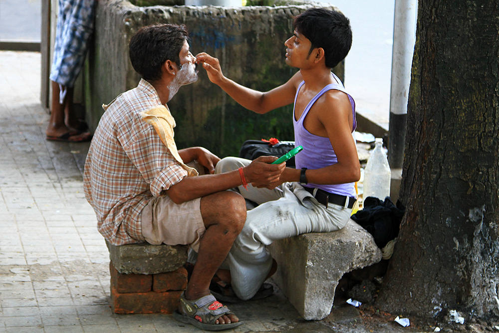 A barber shop on the street in Kolkata, India.