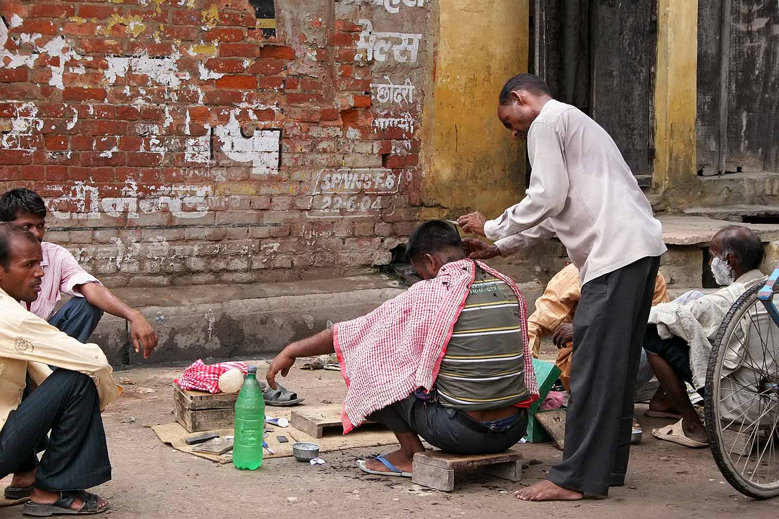 A barber shop in the streets of Varanasi, India.