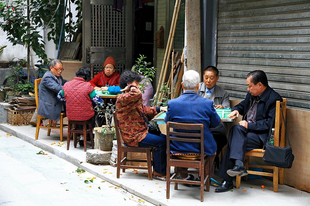 A group people playing Majong in Guangzhou, China.
