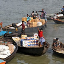 Loading a launch at Sadarghat harbour in Dhaka, Bangladesh.
