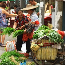 Women sellingg goods at a market in Guangzhou, China.