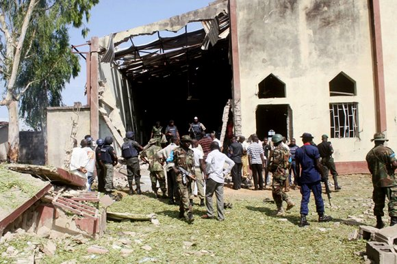 Associated Press - A suicide car bomber attacked a Catholic Church during Mass in Nigeria, killing at least 10 people.