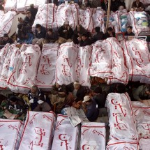 Associated Press/Arshad Butt - Pakistani Shiite Muslims sit in protest next to the dead bodies of their family members killed in Saturday&#039;s bombing
