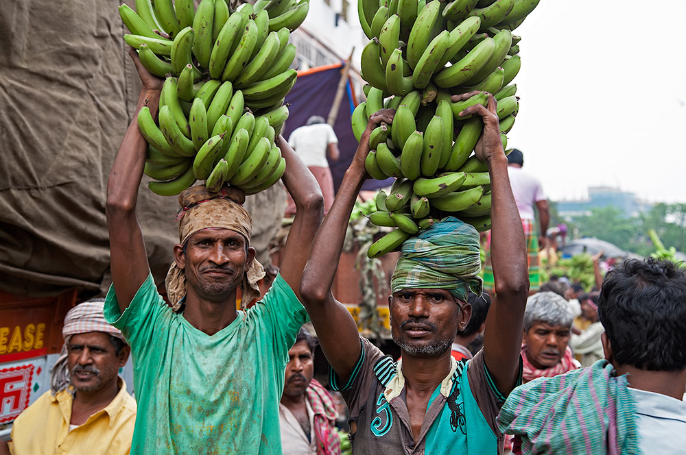 Working men at the the fruit wholesale market in Kolkata, India.