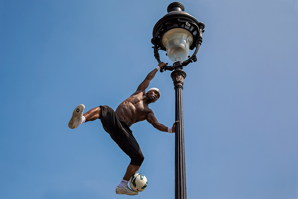 Freestyle footballer Iya Traoré at the Basilica of Sacré-Cœur in Paris, France.