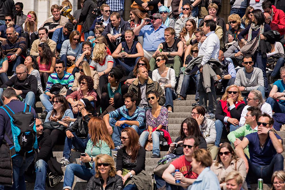 Crowds of people at the Basilica of Sacré-Cœur in Paris, France.