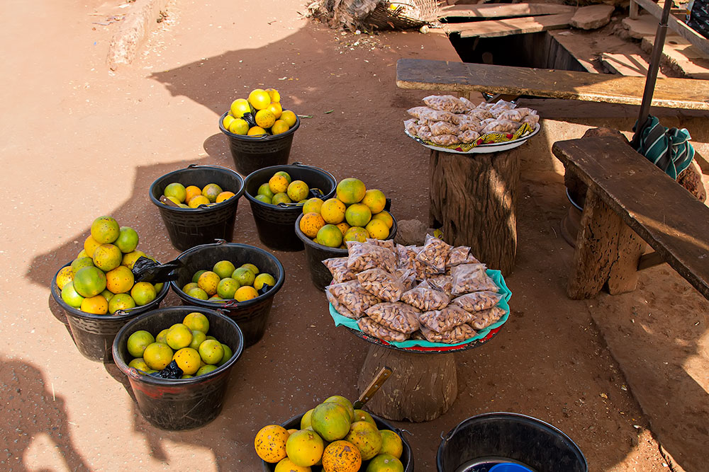 Fresh oranges and the most delicious cashew nuts at the market in Orodara, Burkina Faso.