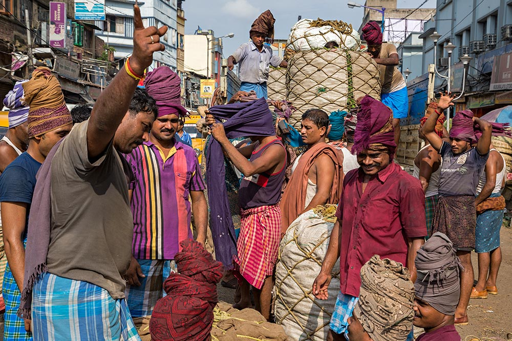 Hard working men at Kolay Market in Kolkata, India.