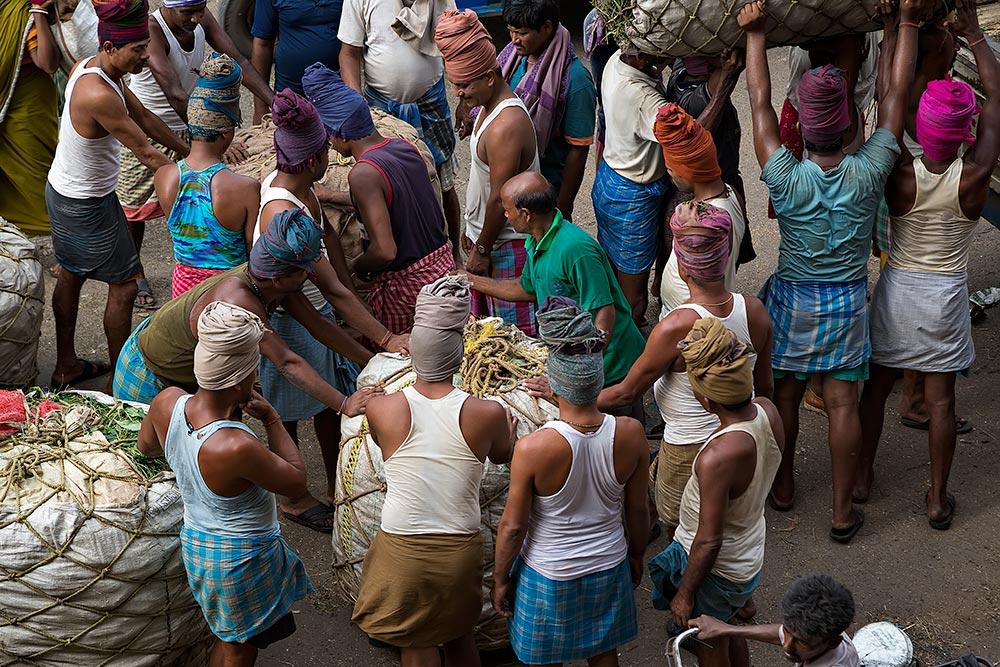 Hard working men at Kolay Market in Kolkata, India.