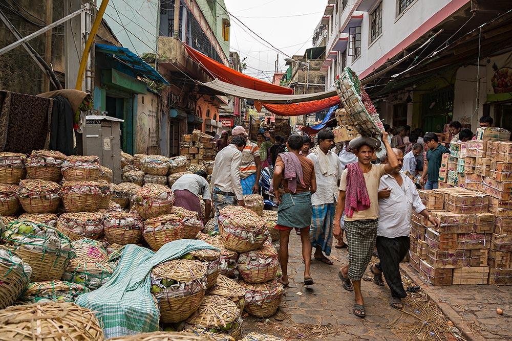 Hard working men at Mechua Market in Kolkata, India.