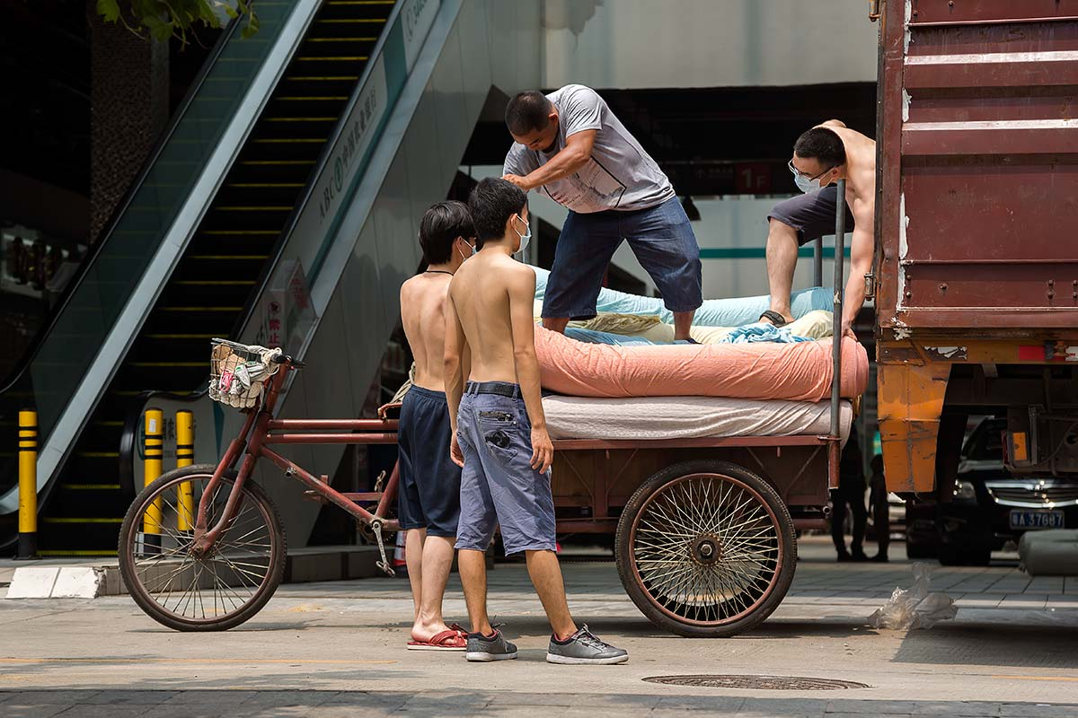 Chinese men unloading a truck in Beijing.