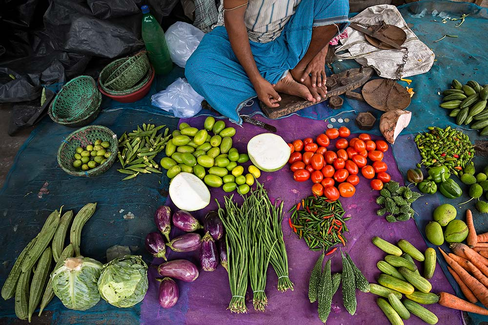 Selling fresh vegetables at Kolay Market in Kolkata, India.