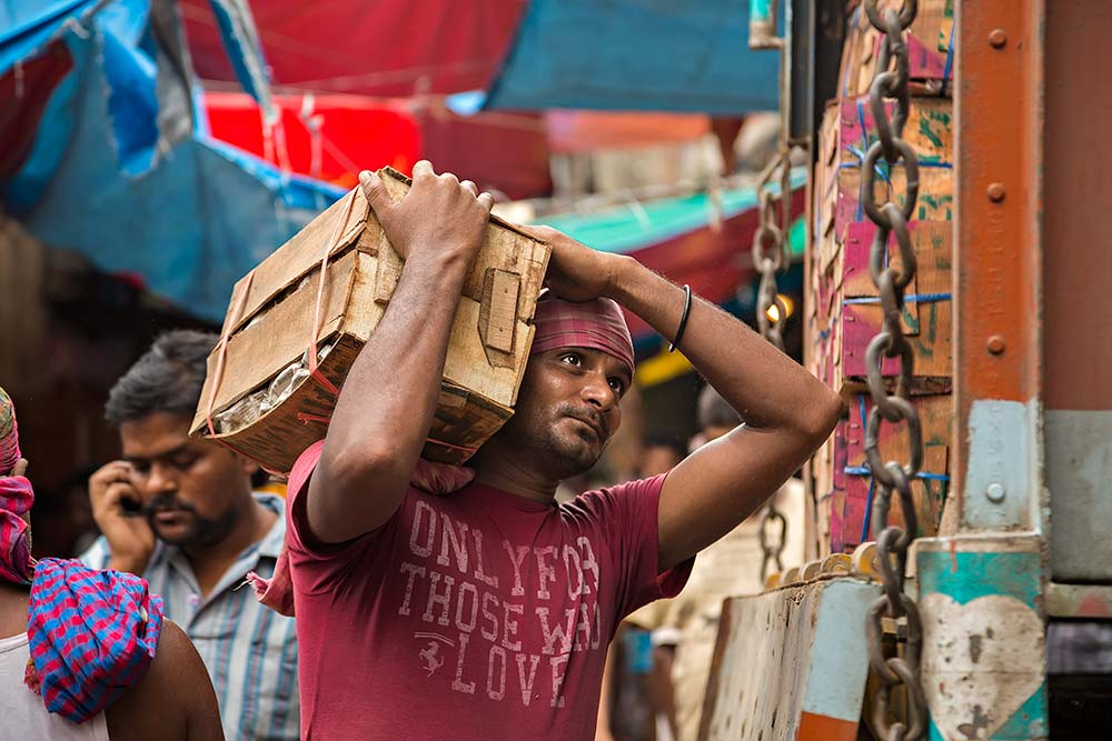 Hard working men at Mechua Market in Kolkata, India.