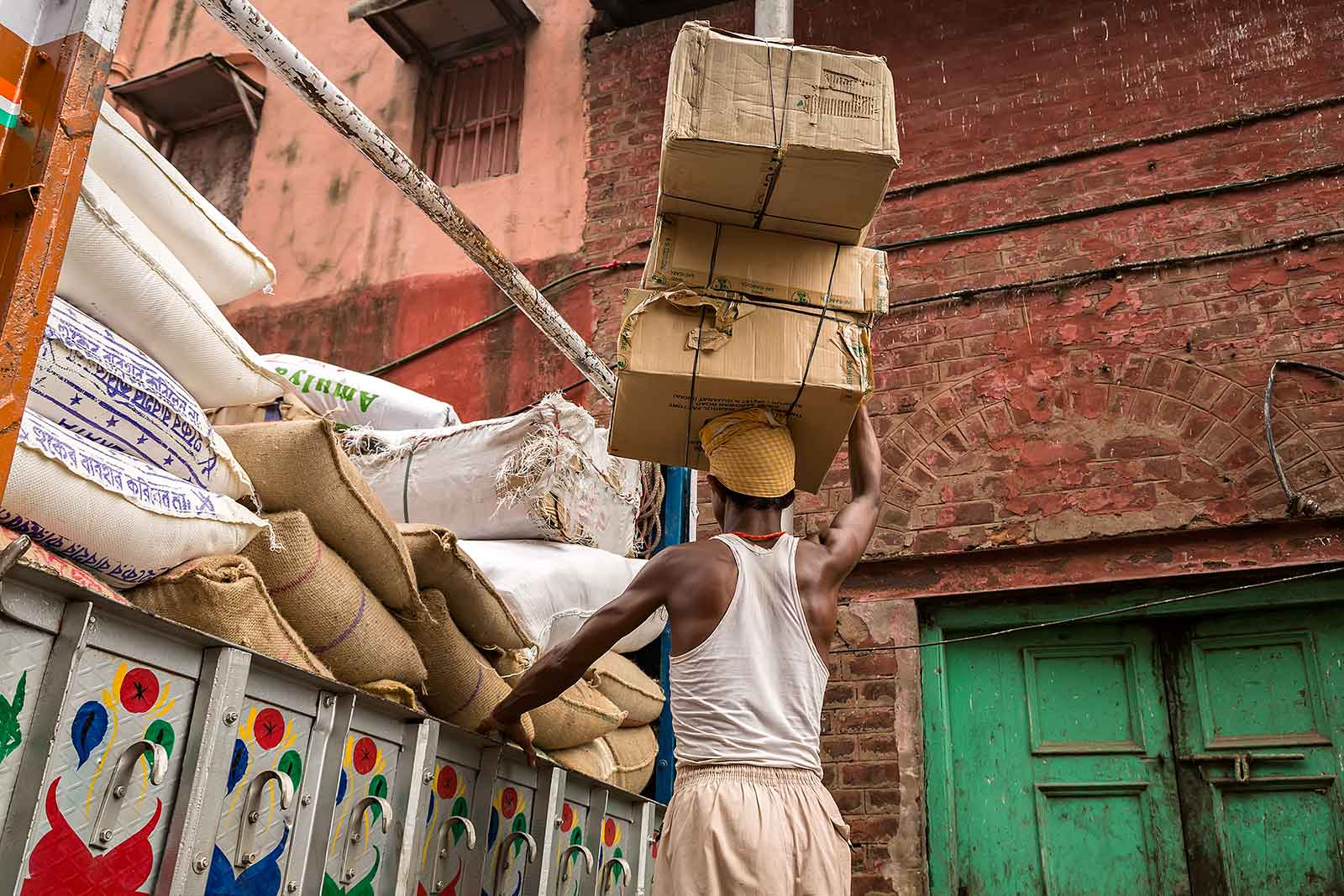 Unloading a truck at Mechua Market in Kolkata, India.