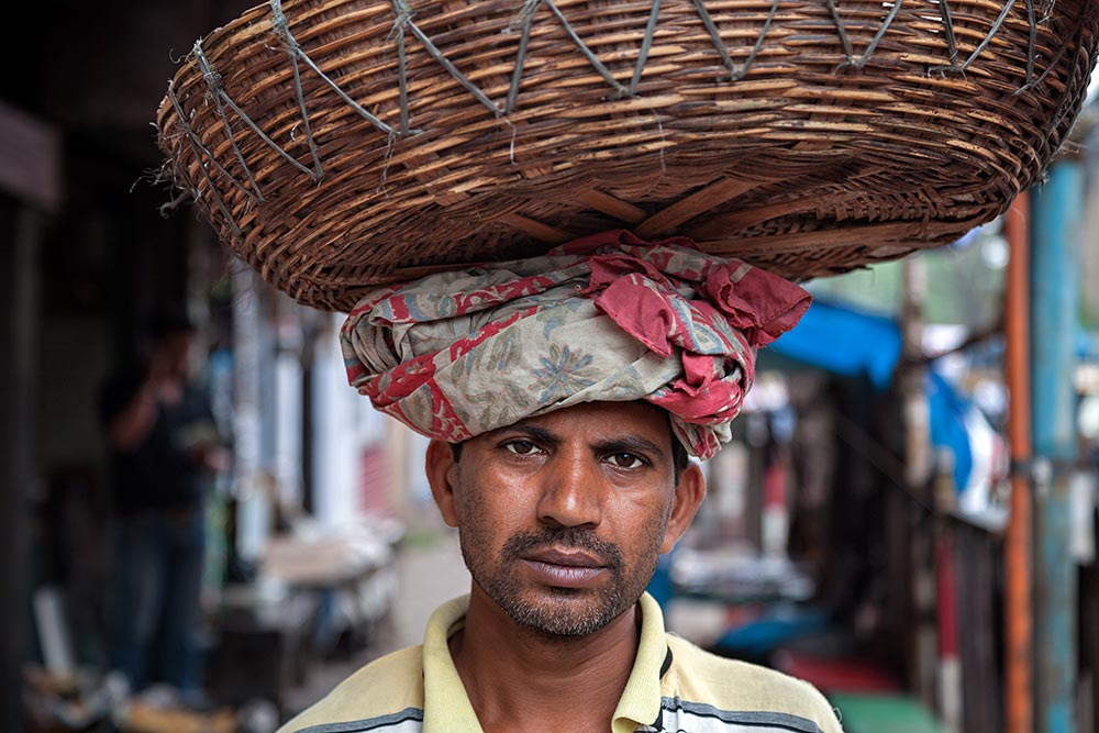 Portrait of a hard working man at Mechua Market in Kolkata, India
