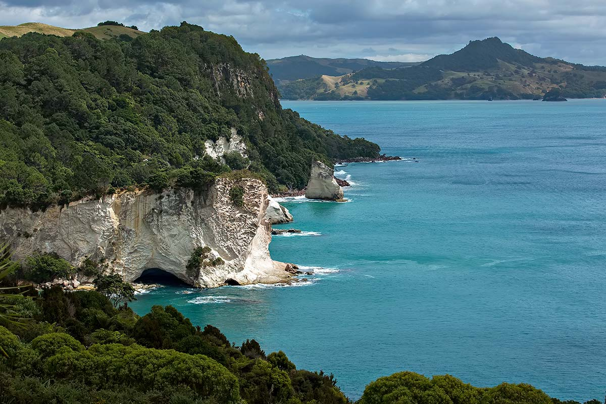 From beautiful Hahei Beach you can walk to Cathedral Cove, where a naturally formed archway deserves photographic attention.