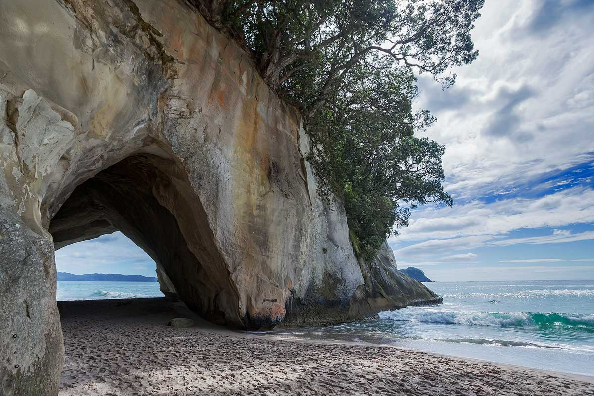 The famous Cathedral Cove. The cathedral-like arch gives whole area an air of grandeur.