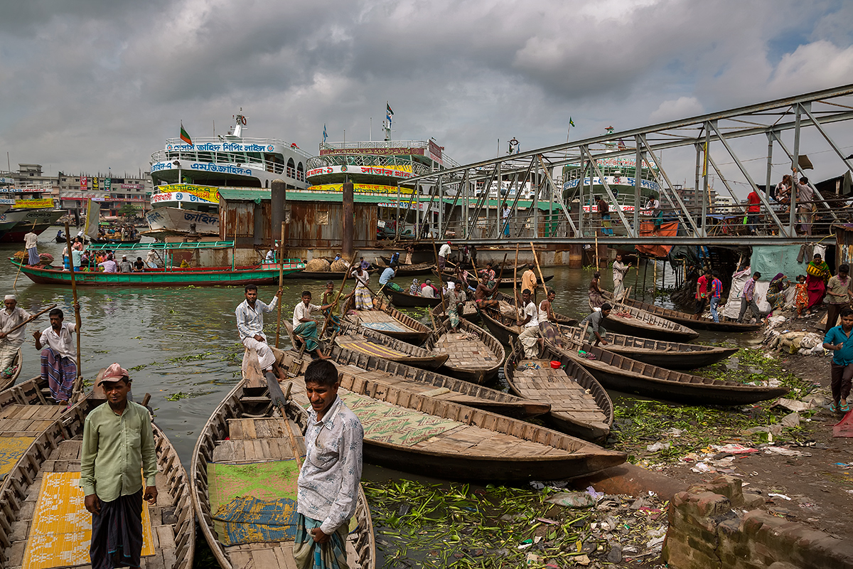The Sampans - the small wooden boats, powered and steered by one oar - are a lifeline in Dhaka, Bangladesh.