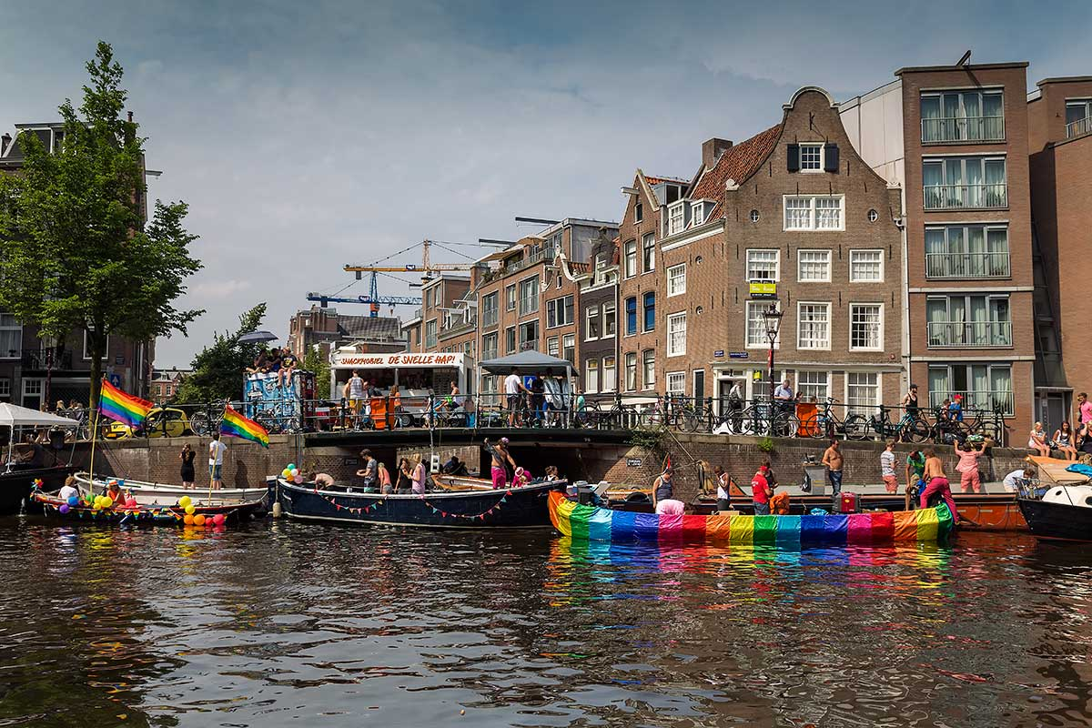 Amsterdammers decorate their own boats along the Gracht to celebrate the Amsterdam Pride Parade.