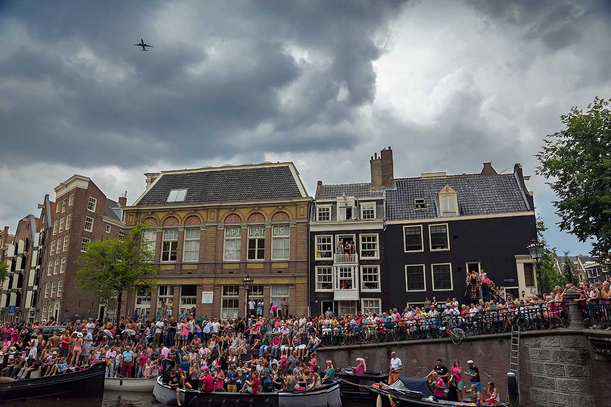 Even the planes diverted their route to fly over the Amsterdam Canal Parade.