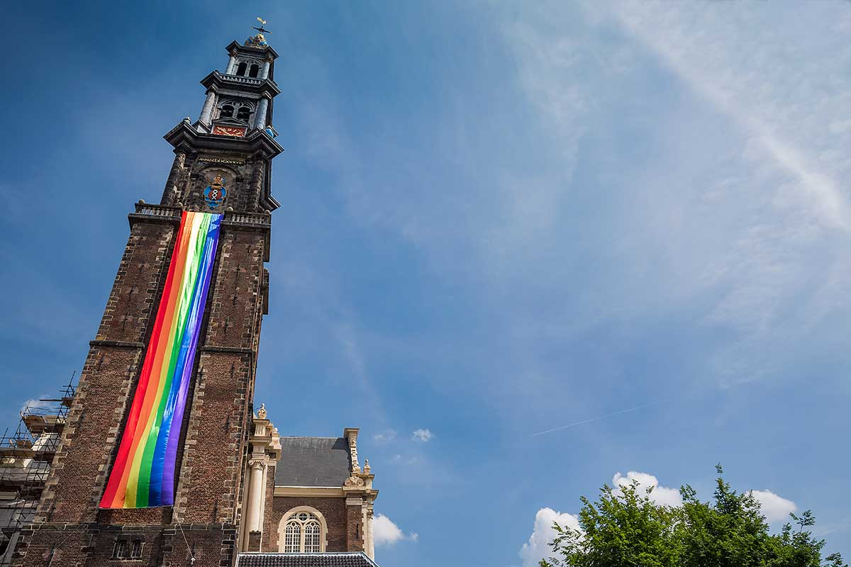 Westerkerk Church was covered in a rainbow flag. Something you unfortunately don't see very often, but in Amsterdam, EVERYONE goes along. | Amsterdam Canal Pride Parade 2014.