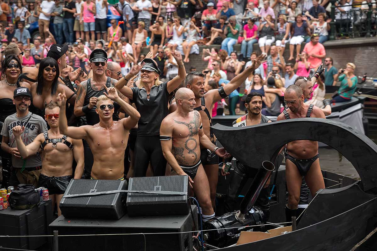 The party crowd didn't let a little rain get in the way of celebrating the 19th annual Amsterdam Pride Parade.