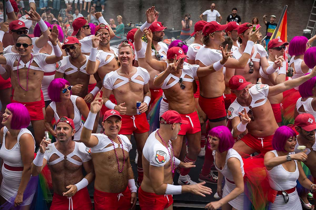 The Amsterdam Pride Parade shows people celebrate equality & freedom together.