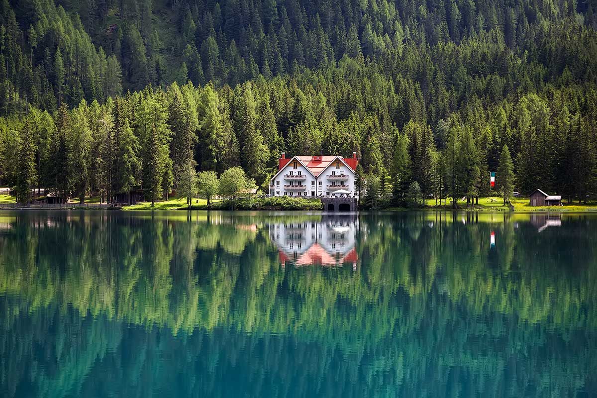 Reflection at the Antholzer See in South Tyrol, Italy.