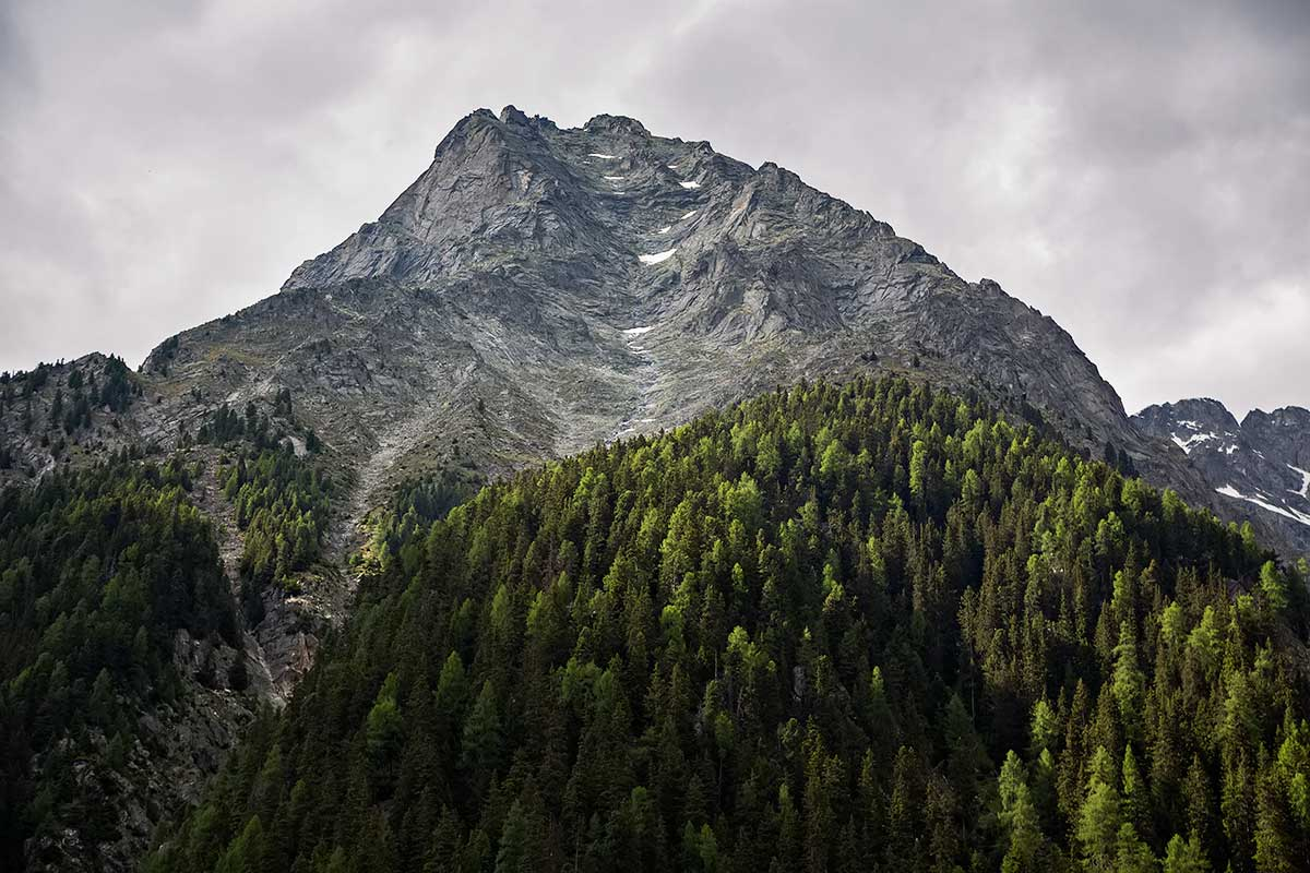 Striking mountains at the Antholzer See in South Tyrol, Italy.