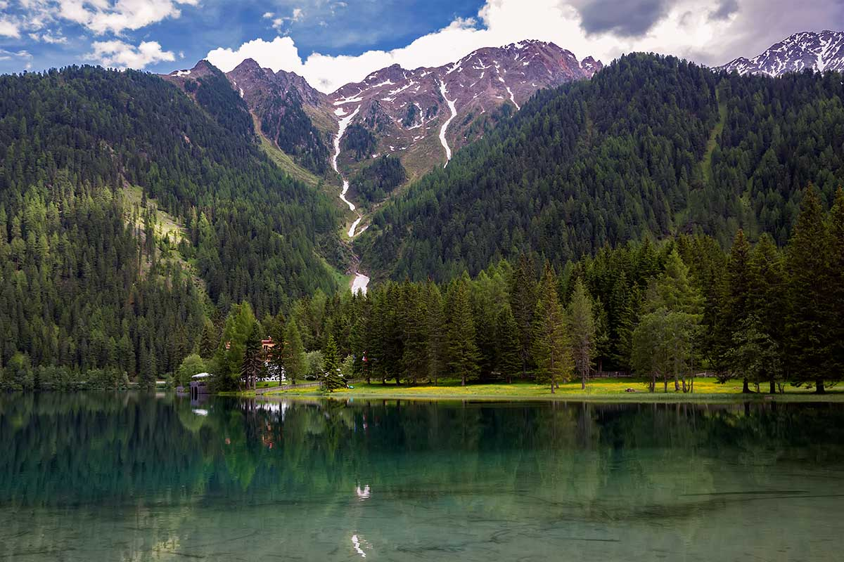 Reflections at the Antholzer See in South Tyrol, Italy.