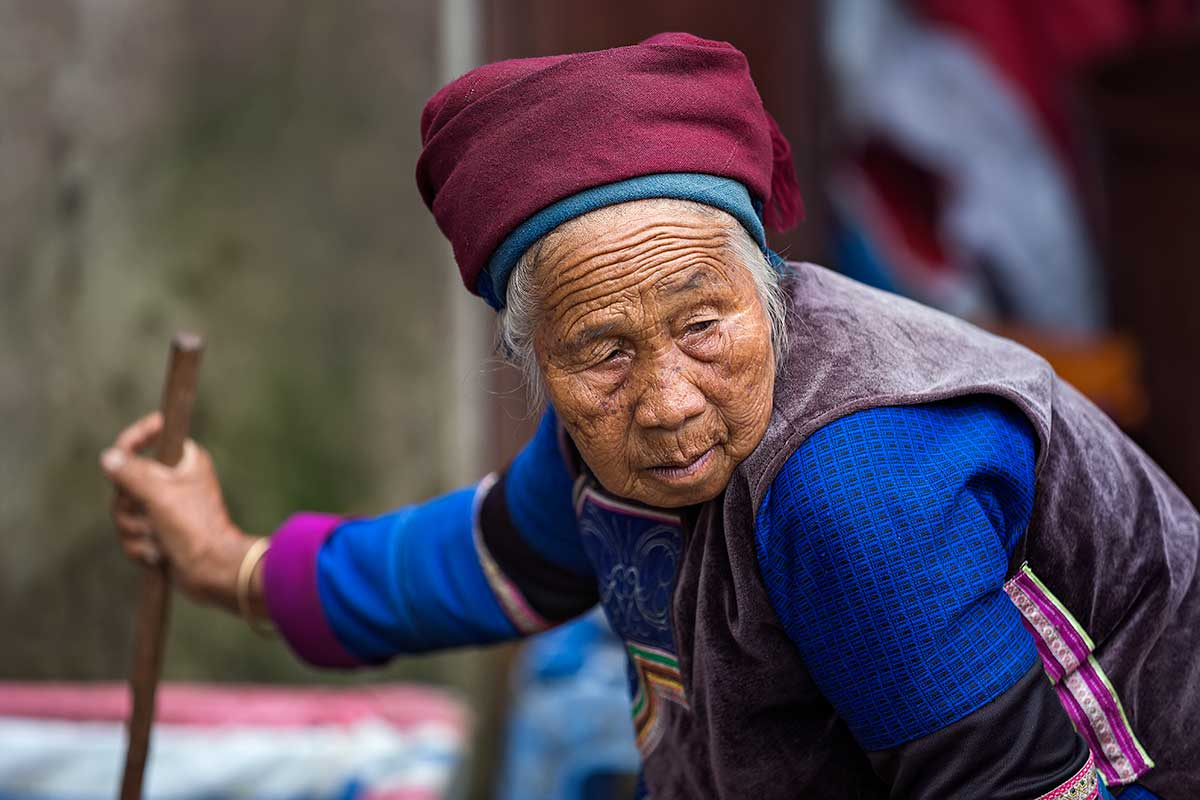 An old woman of the Hani minority at the market in Xinjie, Yunnan Province, China.