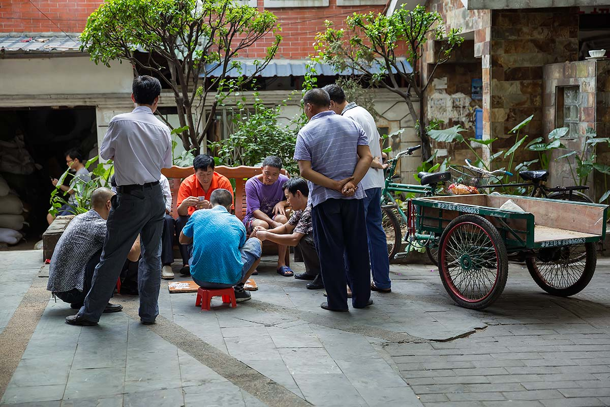 Chinese men playing a game of Mahjong in the streets of Guangzhou.