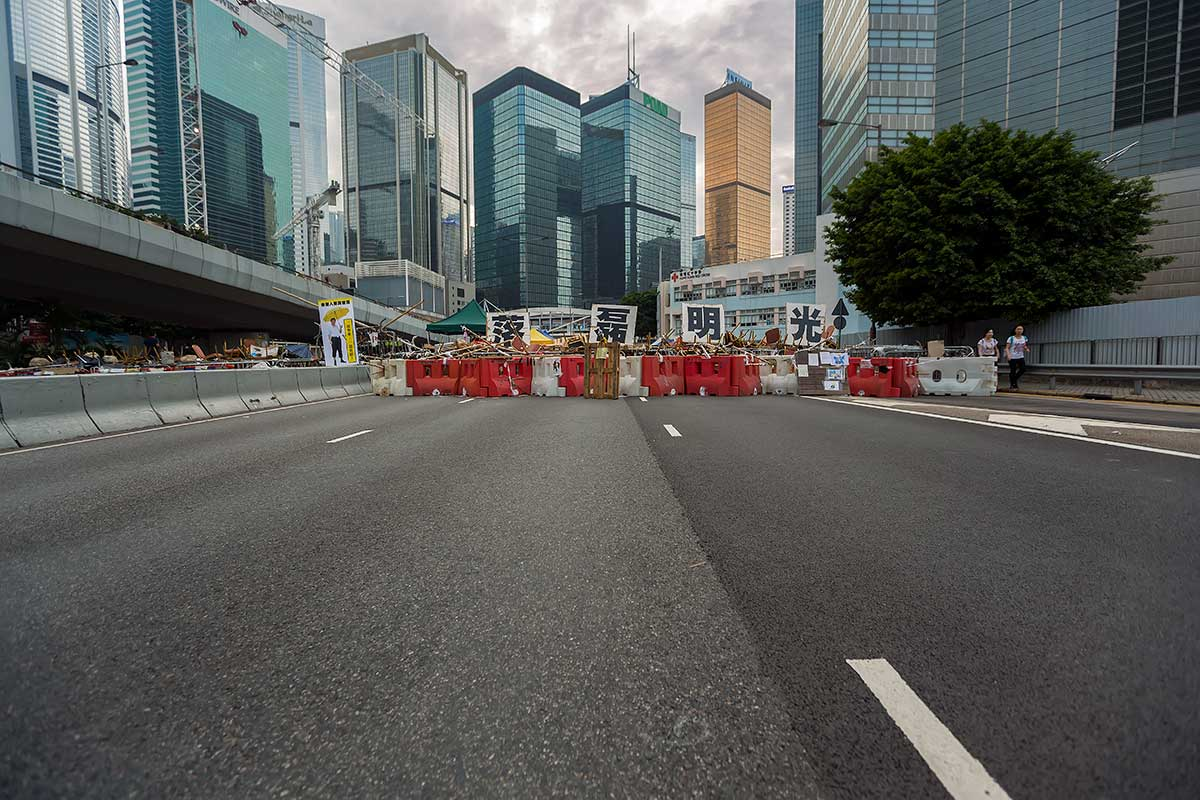 "A four character sign saying ""In the light of honesty"" becomes part of a barricade in Admiralty, Hong Kong.."