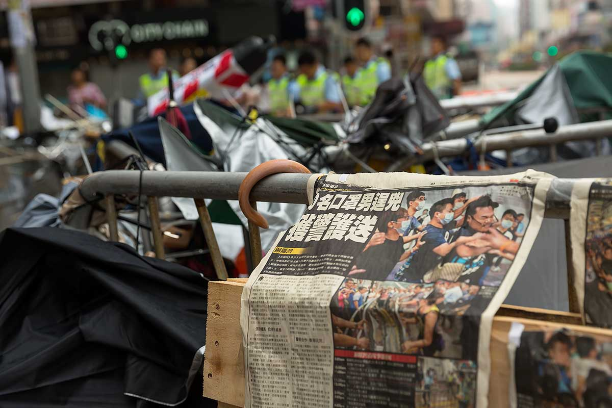 The Umbrella Movement in Hong Kong entered a new phase as police took assertive action to clear protests camps in the Mong Kok district.