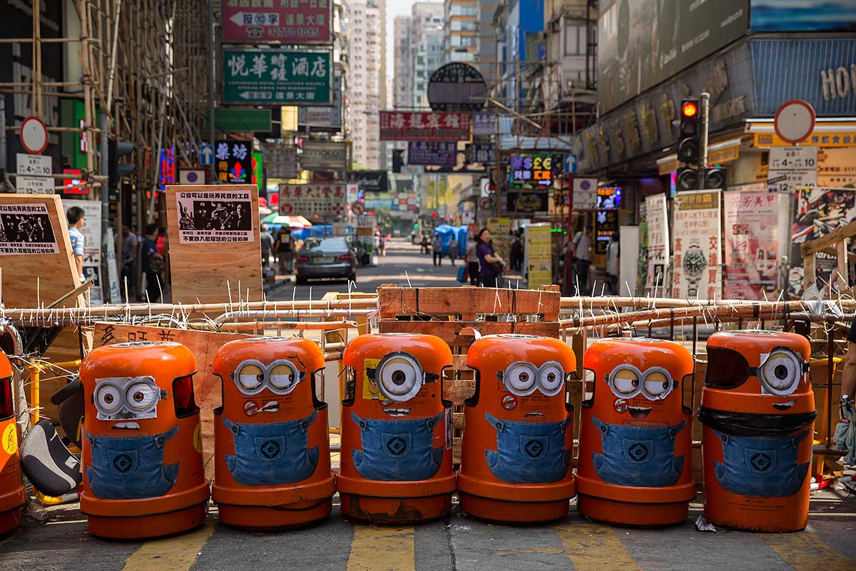 Protesters of the Umbrella Movement cut off traffic in Mong Kok with rubbish bins.