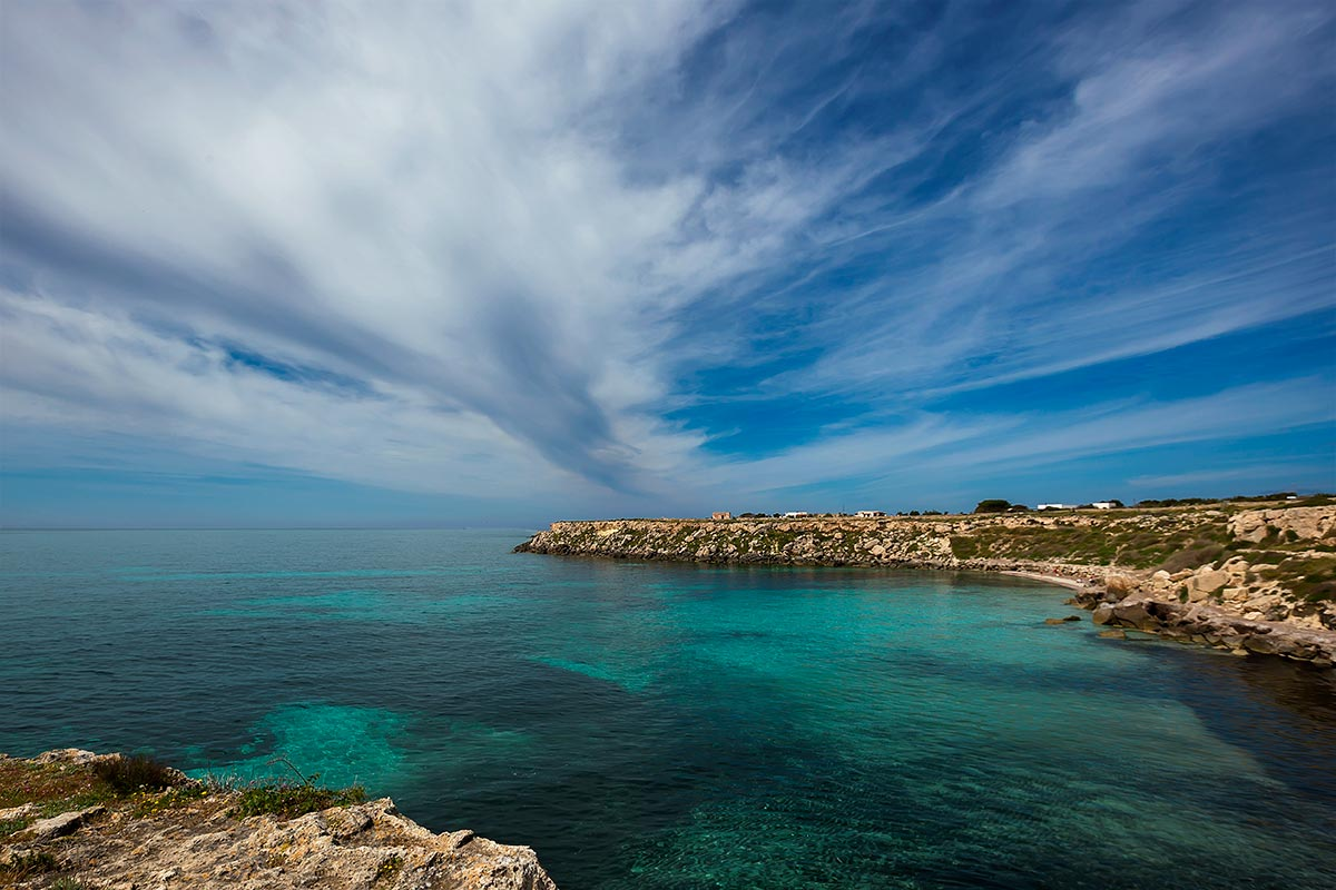 Cala Rossa beach on Favignana island lies a pretty bay with turquoise sea and is one of the most visited beaches of the island.