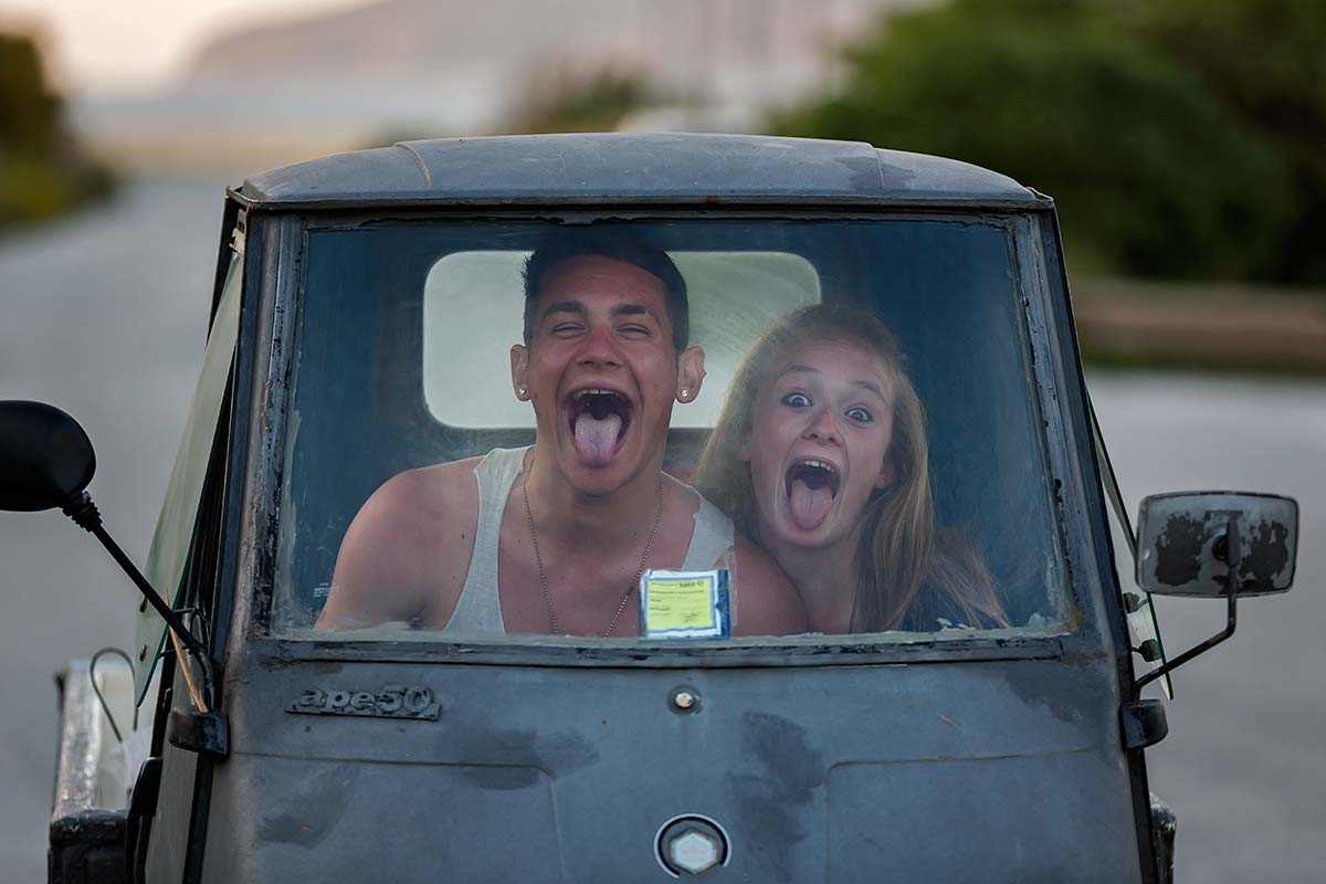 Even though life on the island of Favignana, the younger generation knows how to have fun - here in a cute little Piaggio.