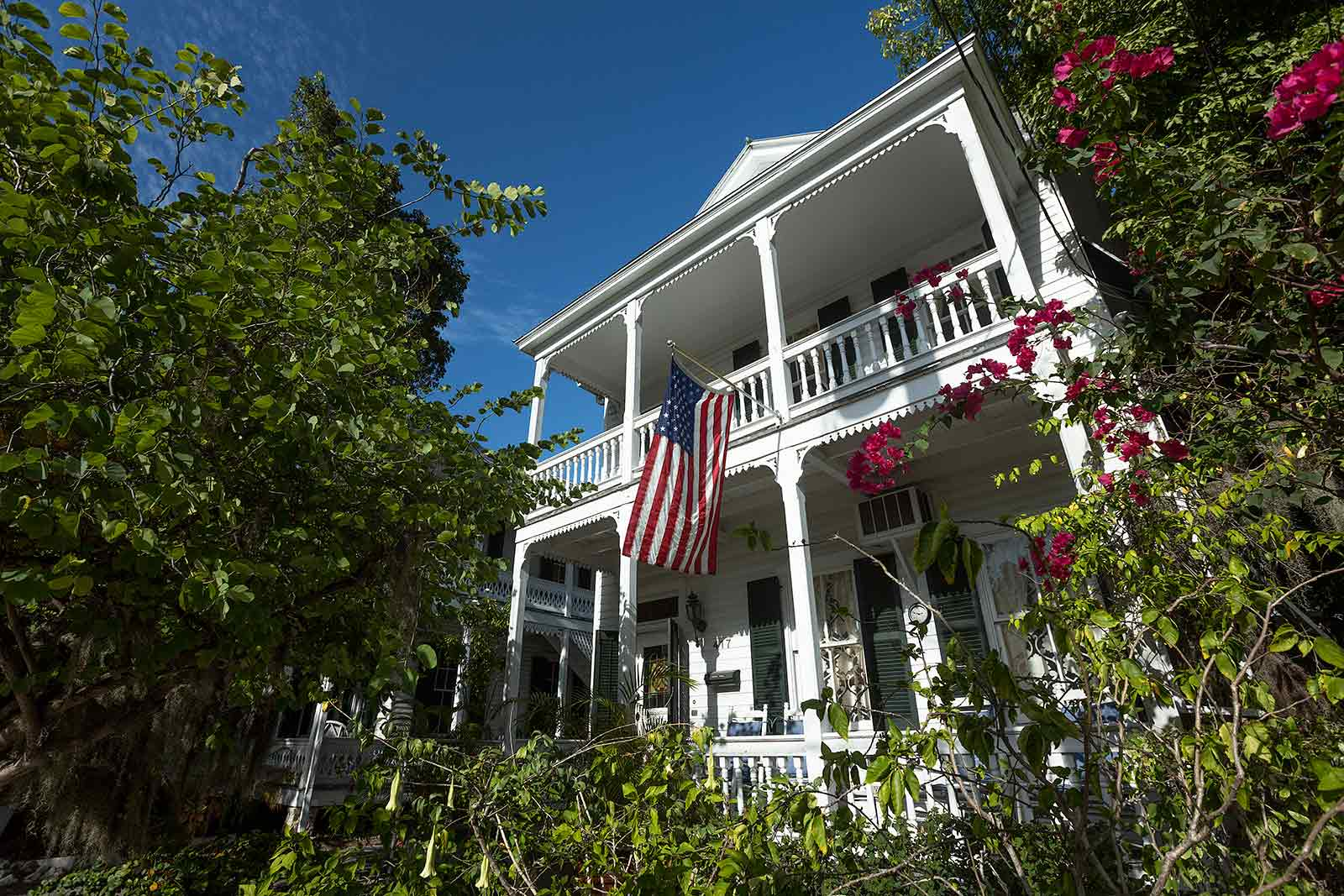 Key West houses feature fanciful elements like slim columns topped with decorative wooden details.