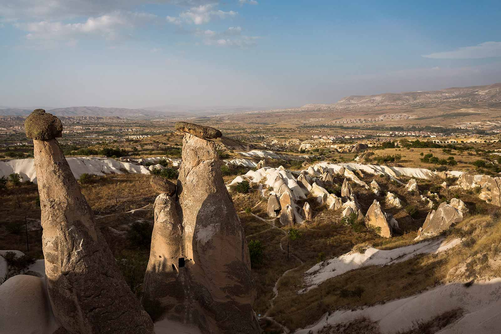 Volcanic eruptions created this surreal landscape of Cappadocia. The lava flows formed tuff rock, which wind and rain sculpted into sinuous valleys with curvy cliff faces and pointy fairy chimneys.