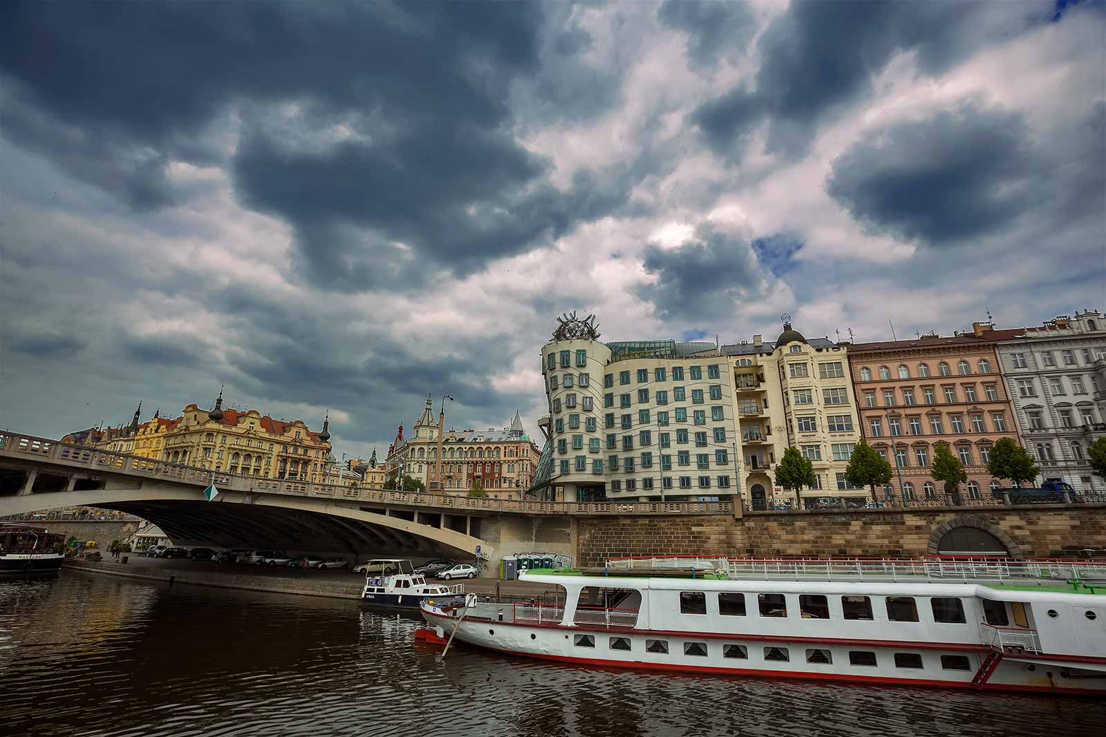 The Dancing House (designed by architects Vlado Milunic and Frank Gehry) in Prague is set by the Vltava River. Its design is unique, and especially striking in the city centre because it is a modern building surrounded by historic architecture.