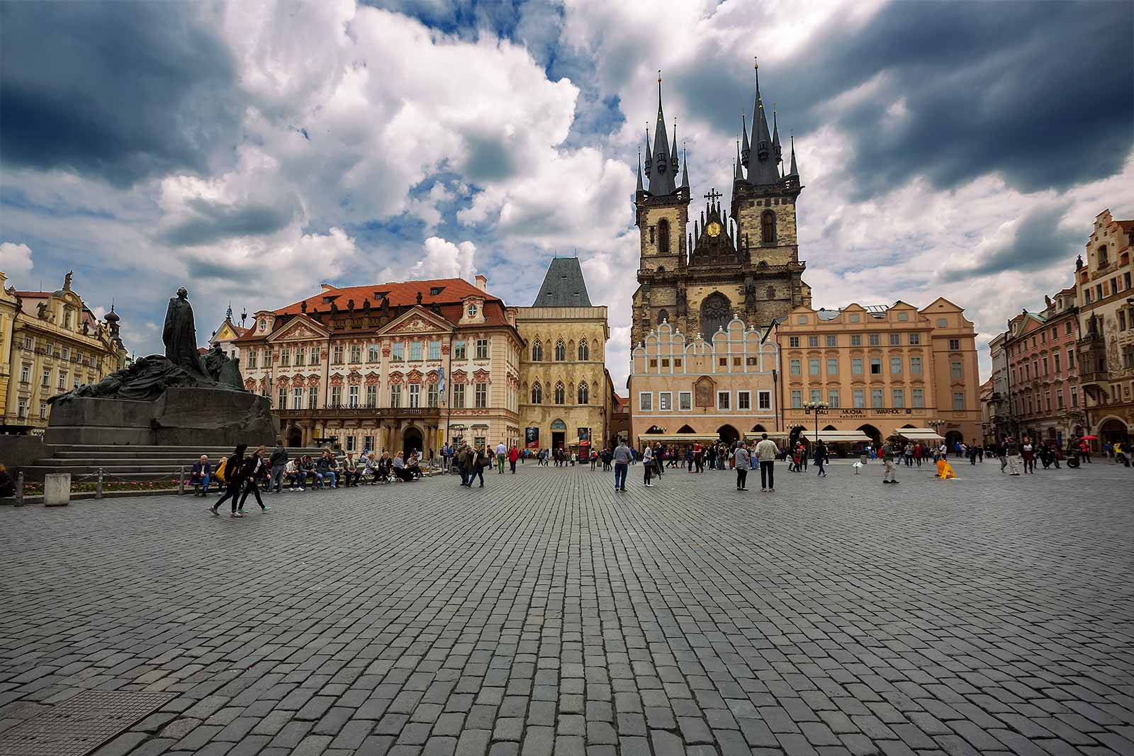 The most notable sights on the square are the Old Town Hall Tower & Astronomical Clock, Tyn Church and St. Nicholas Church. At the centre (left in this photo) of the Old Town Square is the Jan Hus statue.