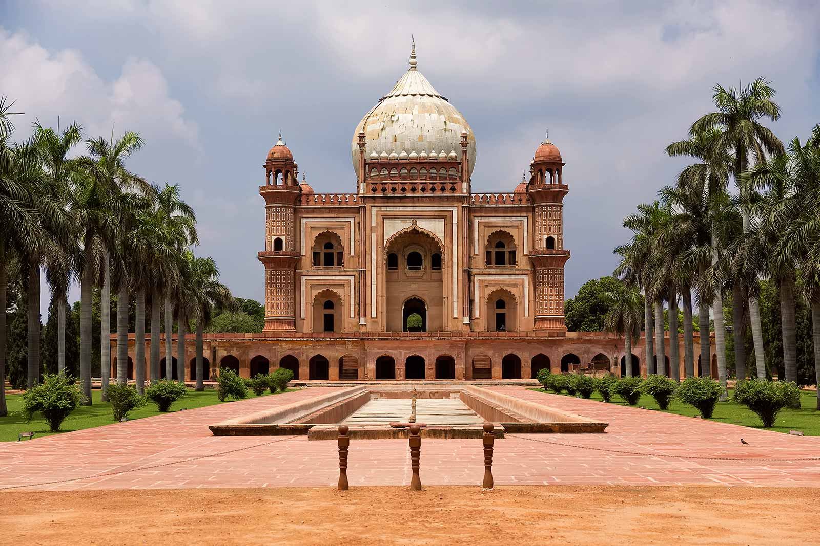 Safdarjung's Tomb is a double storey mausoleum built with red and buff sandstone. The garden is divided into four squares by side pathways and tanks which are again divided into smaller squares and pathways.