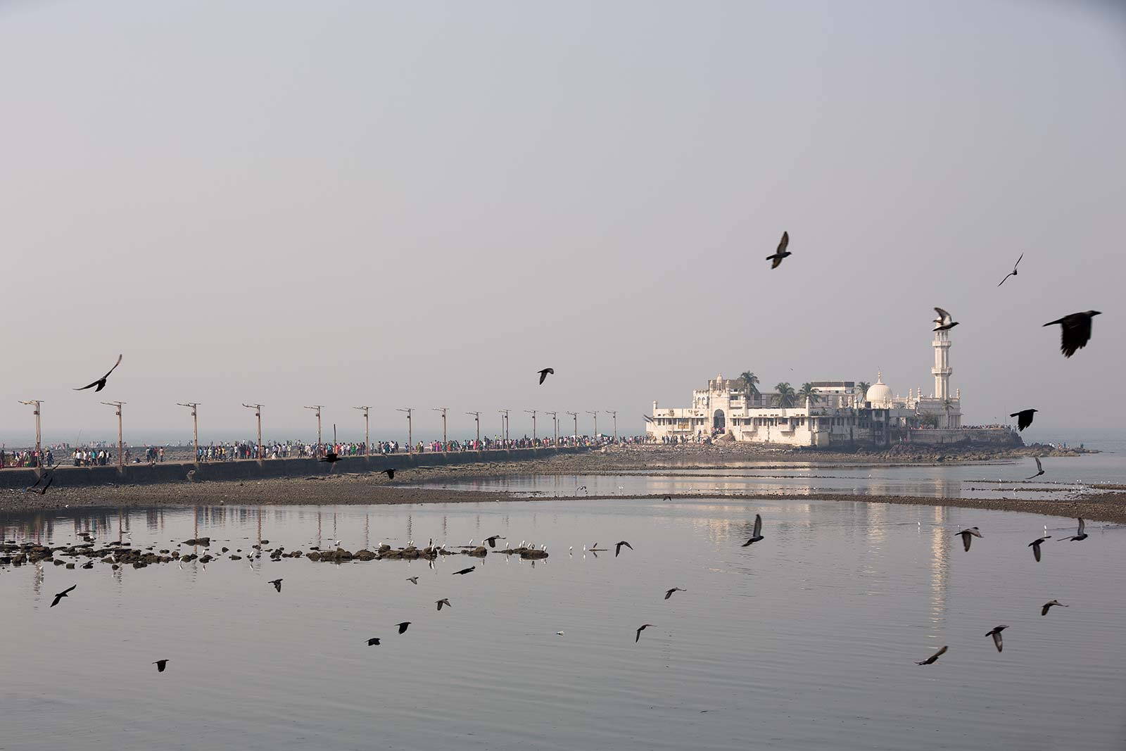 Built in 1431, this Mughal-style architectural marvel serves as a reminder of the city's rich and multicultural history. The six-hundred-year-old dargah is dedicated to the memory of Sayyed Pir Haji Ali Shah Bukhari. Sitting atop a set of large rocks in the sea, the Haji Ali Dargah features stunning white-marble pillars, domes and minarets, which showcase Indo-Islamic architecture at its finest.